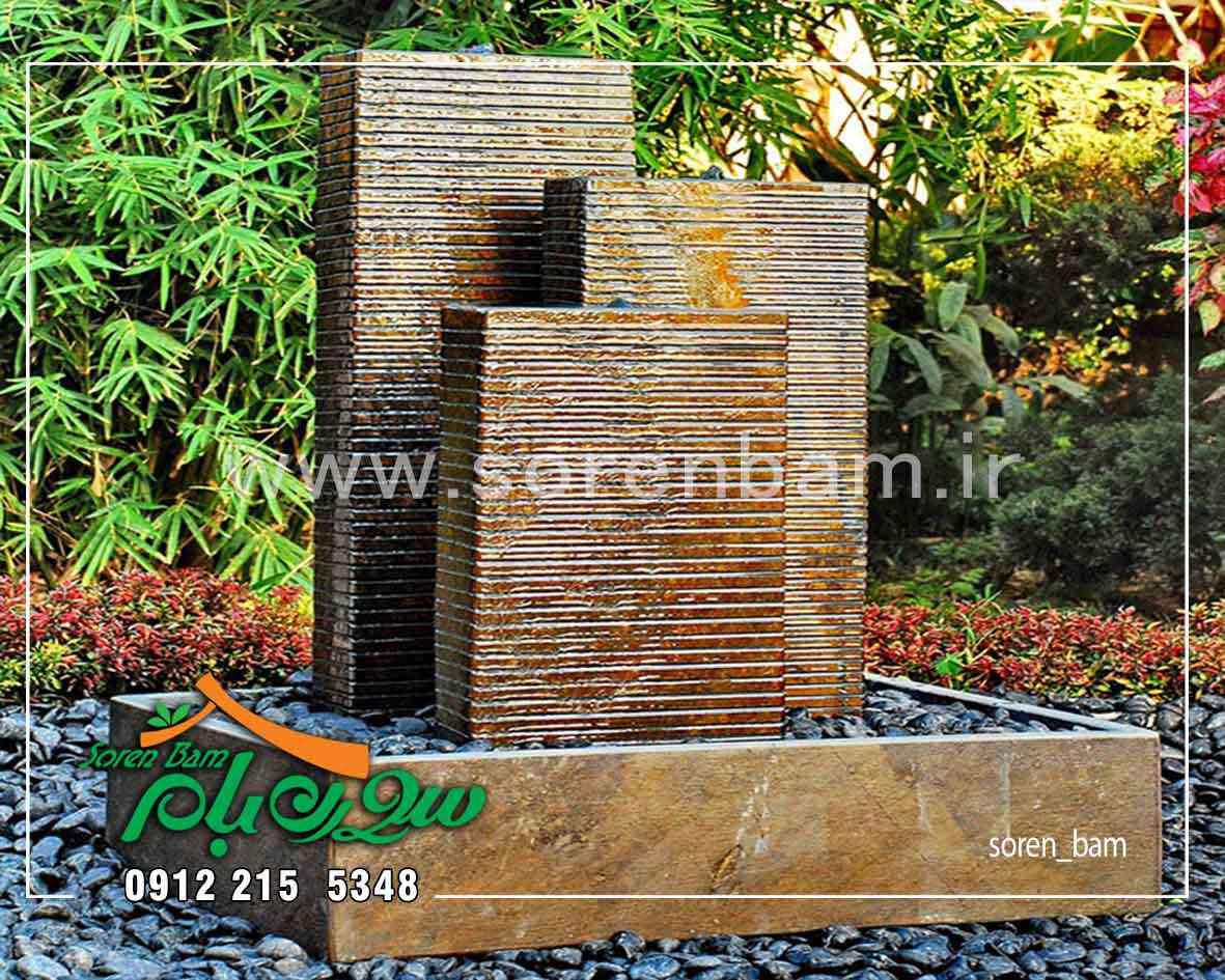 اجرای آبنمای سنگی در باغ