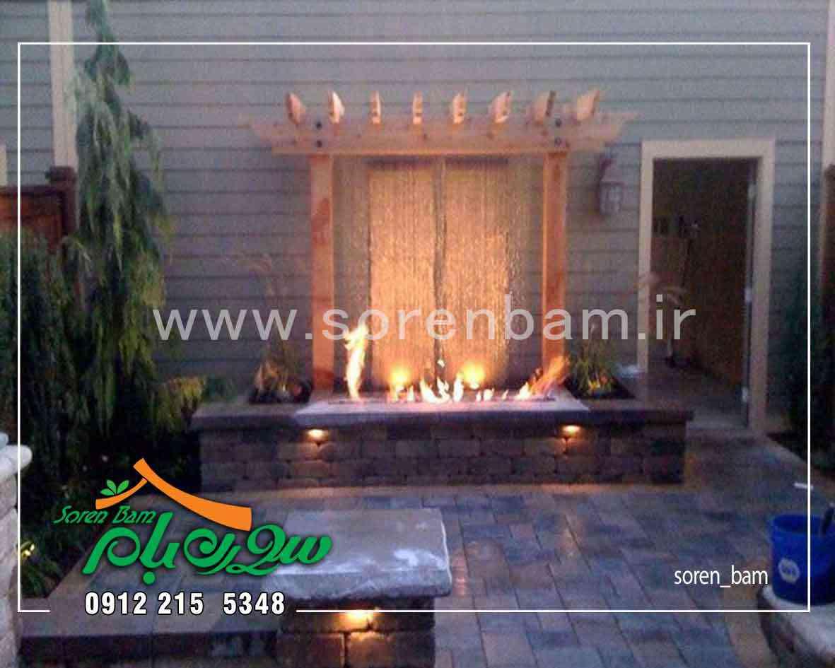 آبنمای آب و آتش دیواری در محوطه باغ